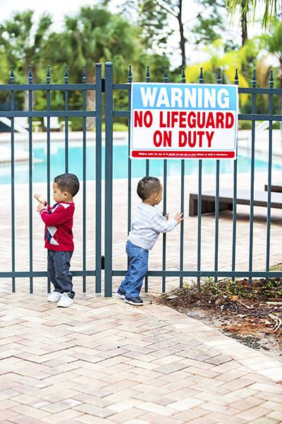 Kids by pool fence